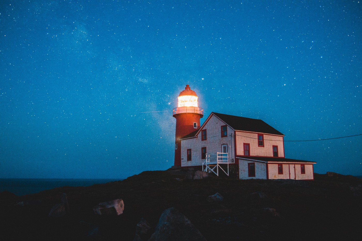 Picture of a lighthouse in the dark.