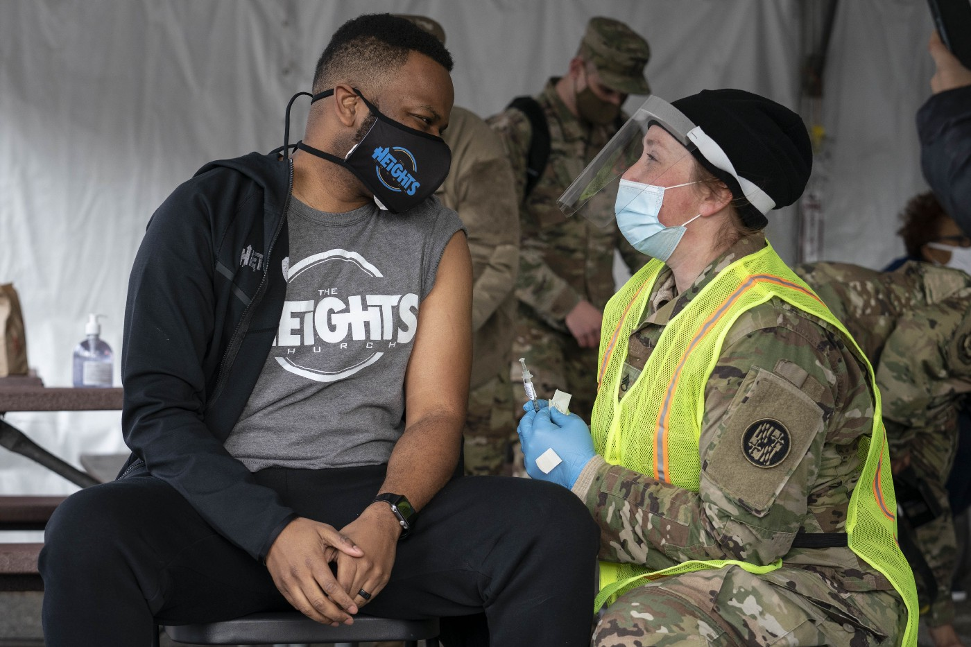 A man speaks with a member of the National Guard after receiving a coronavirus vaccine in the parking lot of Six Flags on February 6, 2021 in Bowie, Maryland.