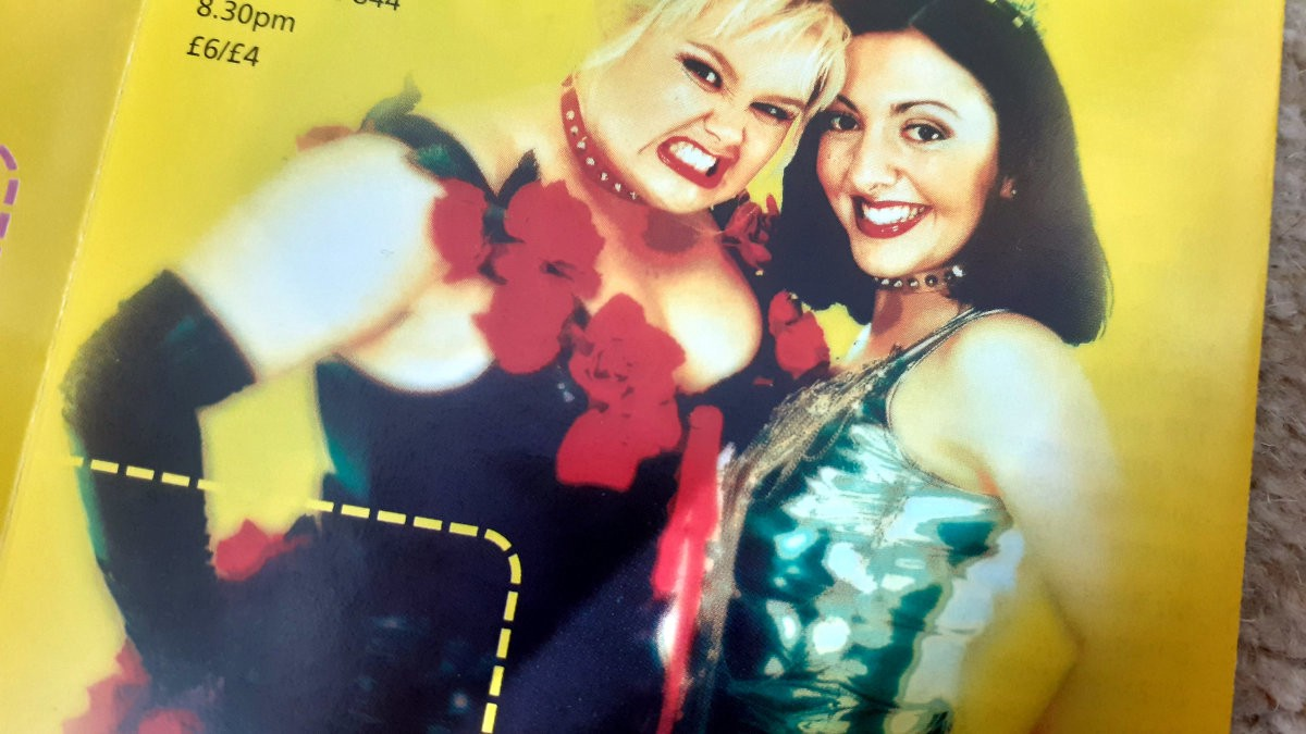 A photo of the festival's 2001 brochure featuring Australian comedy/ musical duo, Supergirly.