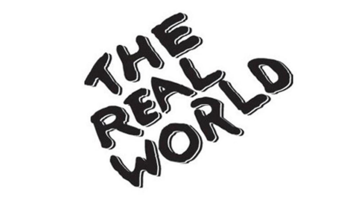 The original logo for The Real World, in sideways scrawled black lettering, all caps