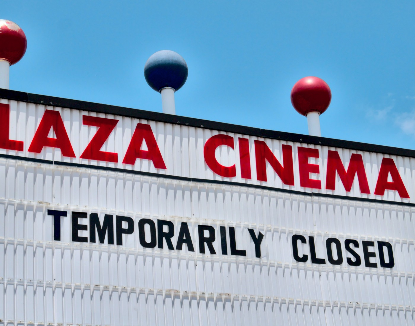 "A marquee reading, ""Plaza Cinema: Temporarily closed."""