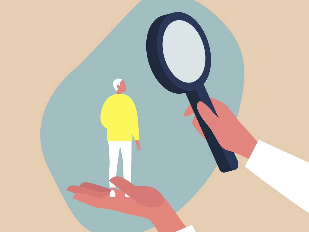 Conceptual drawing of a man being examined with a magnifying glass.