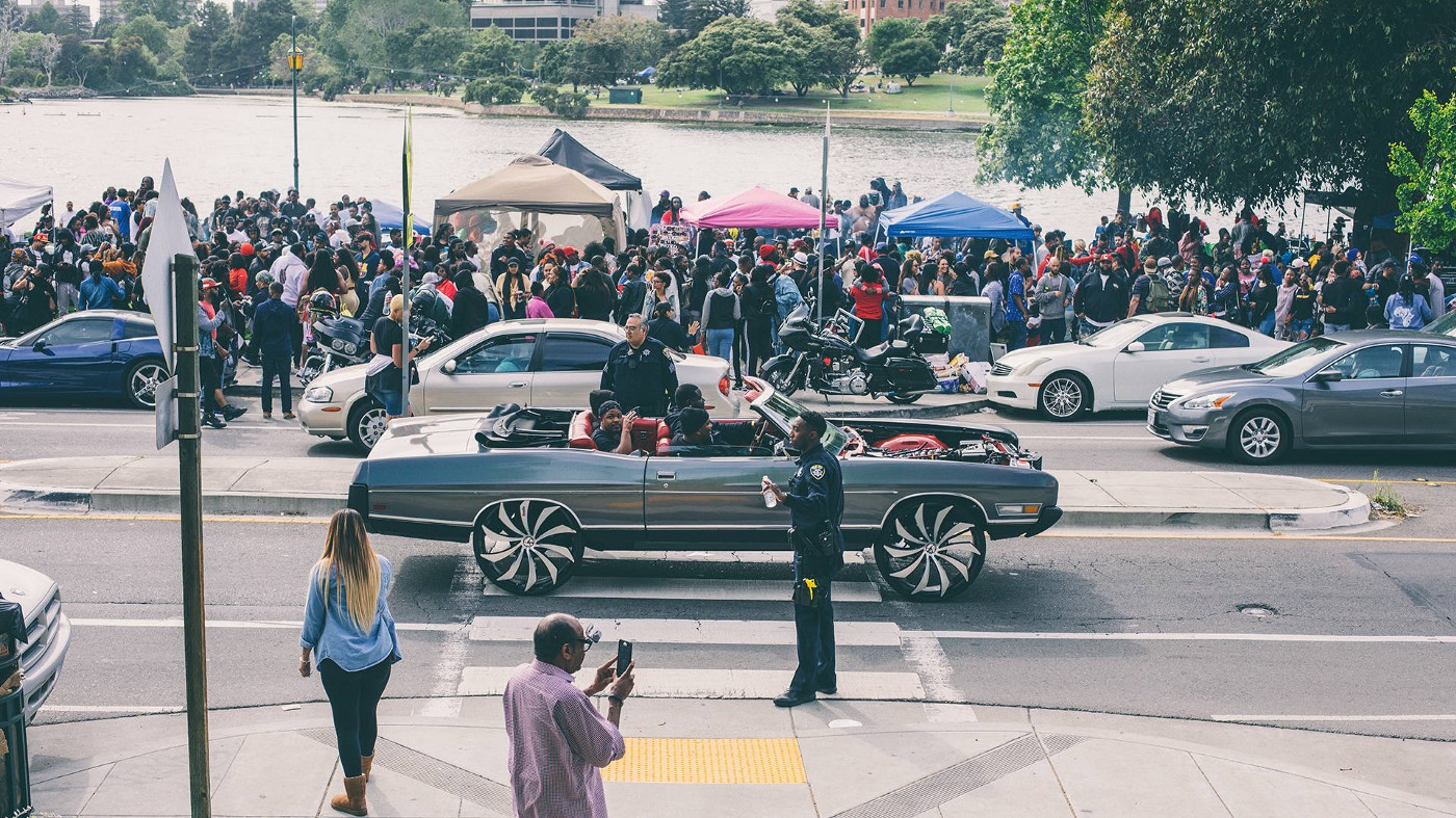 Scraper drives by crowd at Lake Merrit during creative protest, BBQ'n While Black