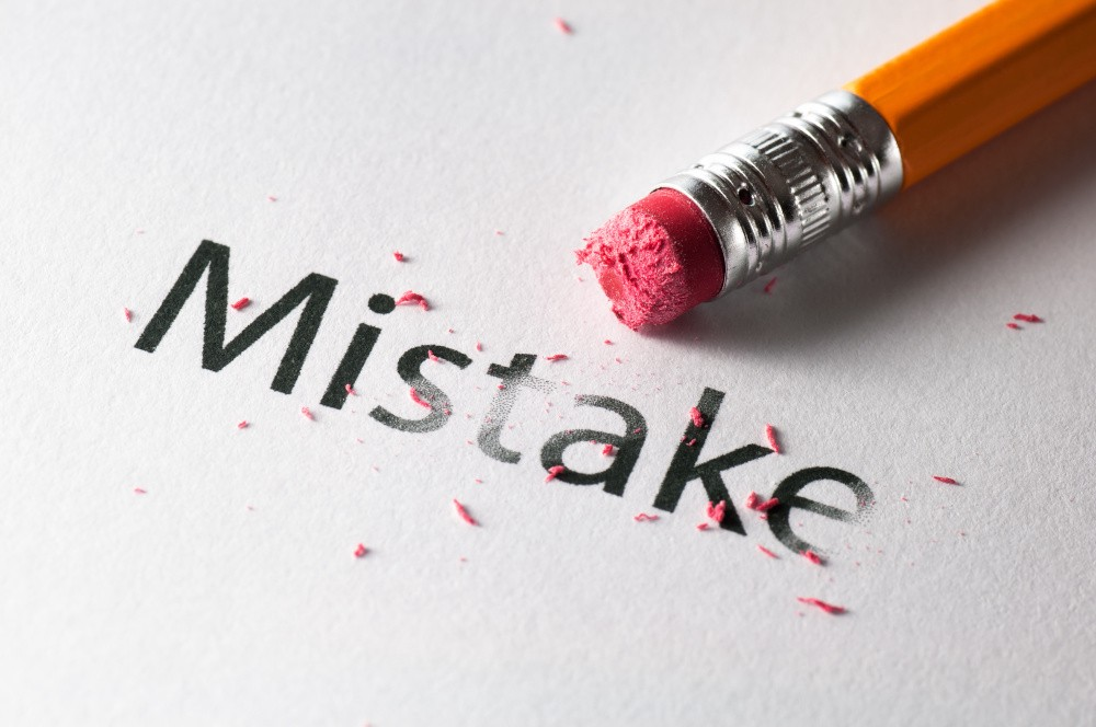 A pen and the word Mistake