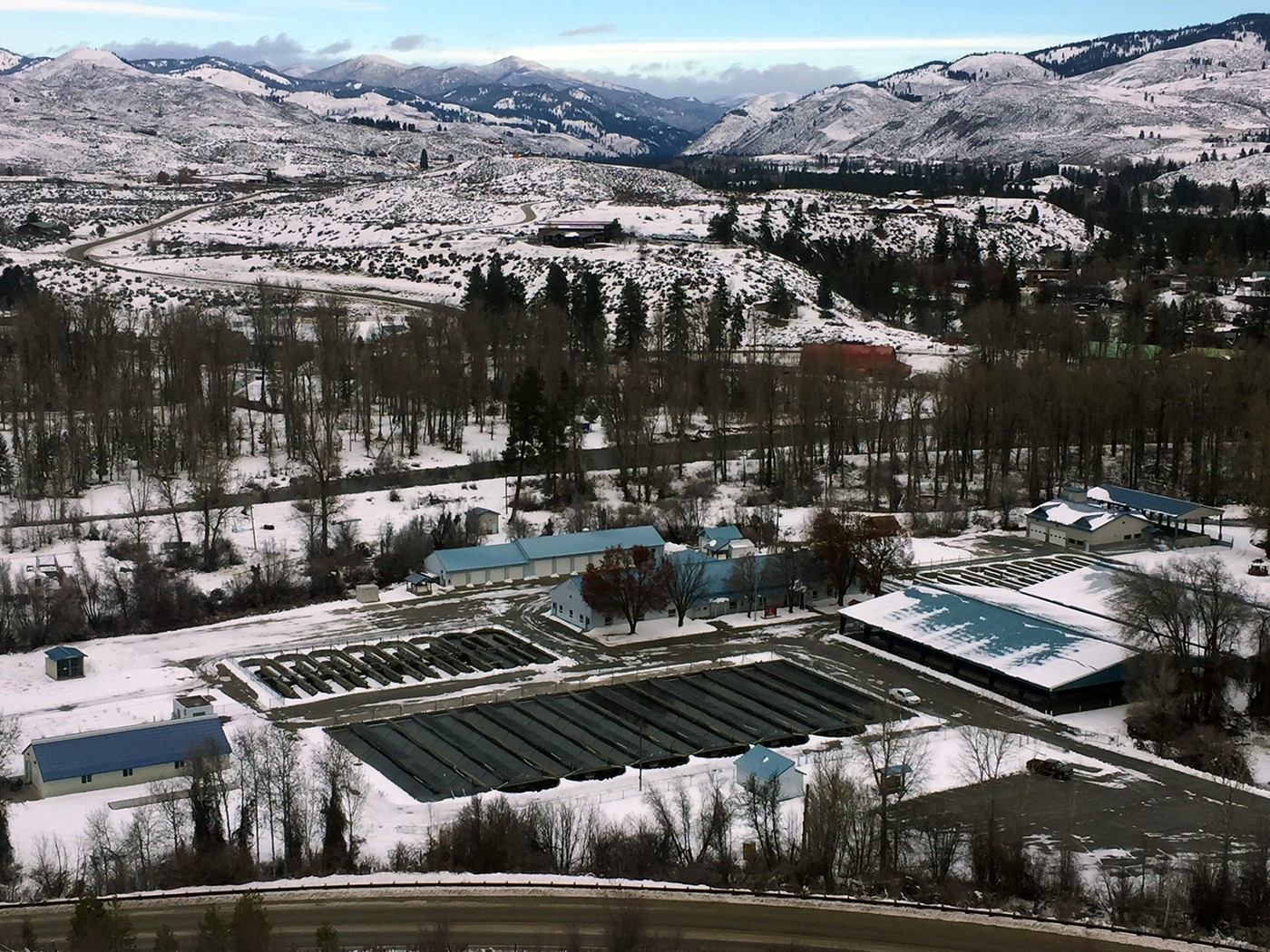 An aerial view above the Winthrop National Fish Hatchery in Washington covered in snow.