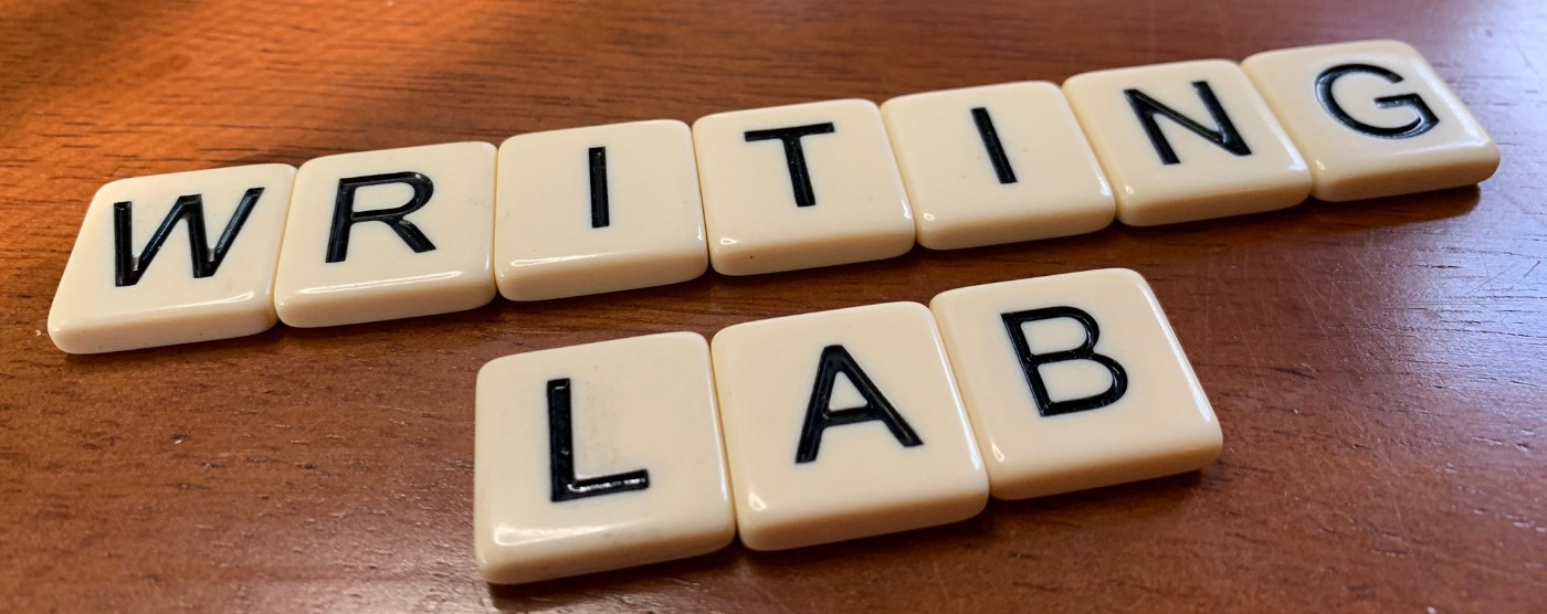 "Tile letter spelling out the phrase, ""Writing Lab""."