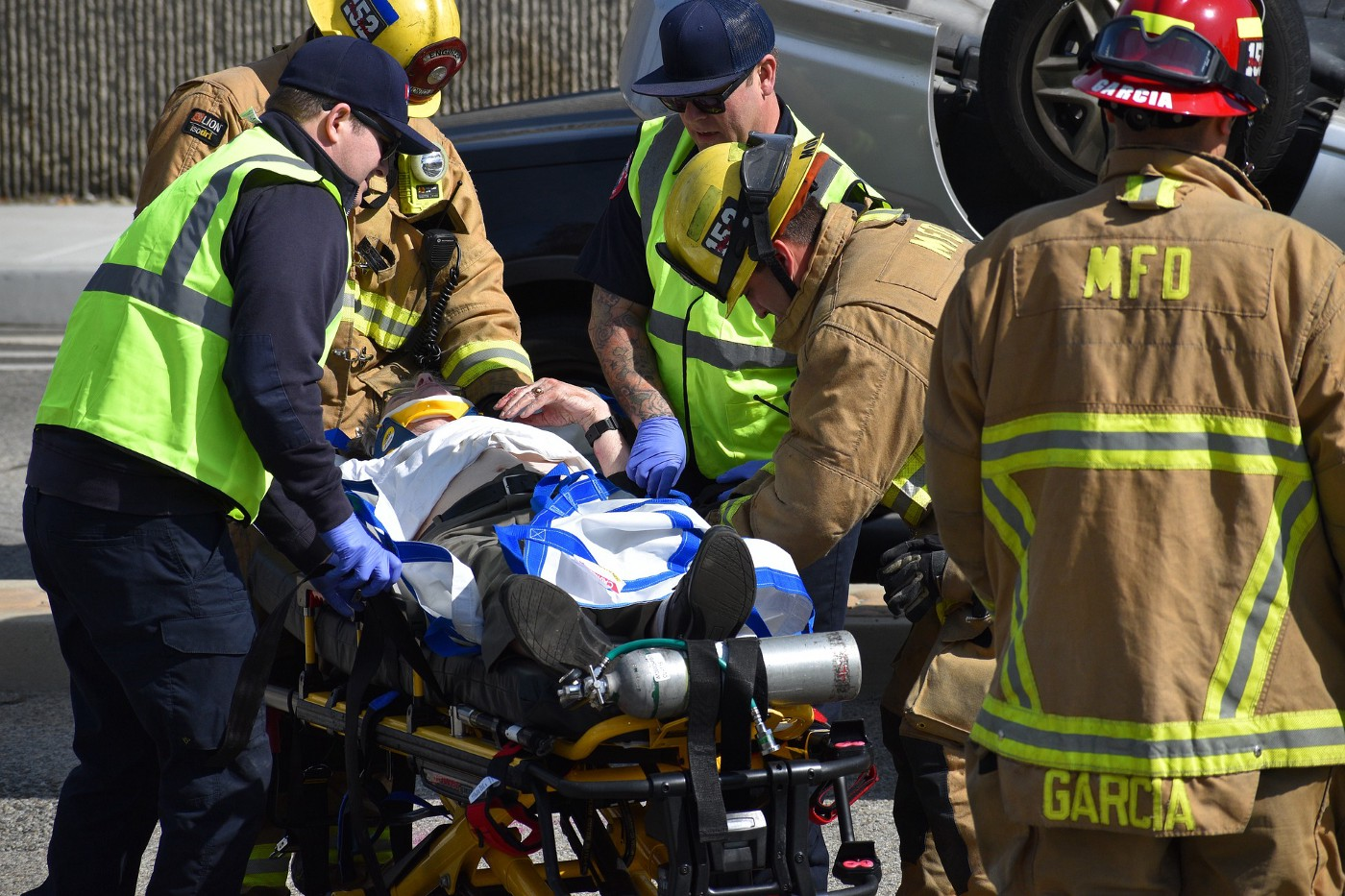 First responders move a person on a gurney