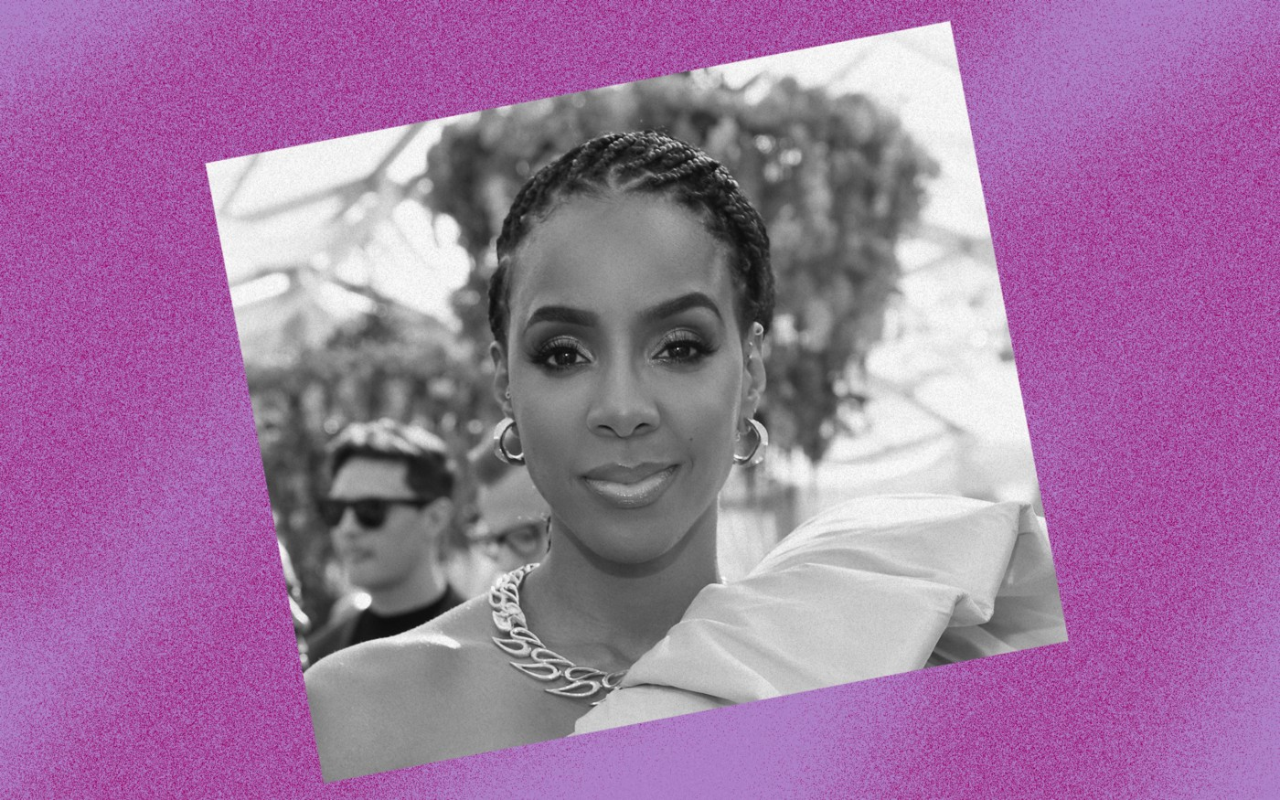 Black and white photo of Kelly Rowland against a violet background.