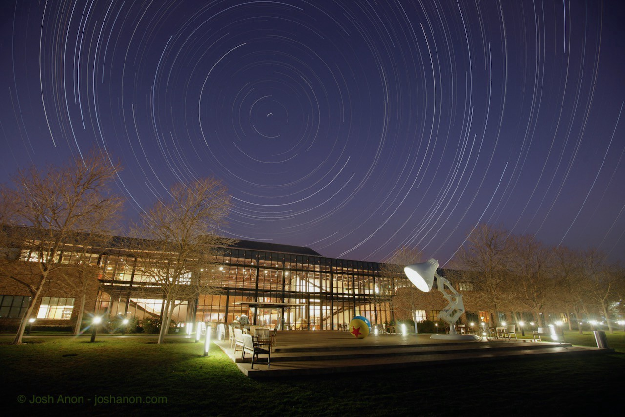 Star trails over the front of the Steve Jobs building at Pixar Animation Studios