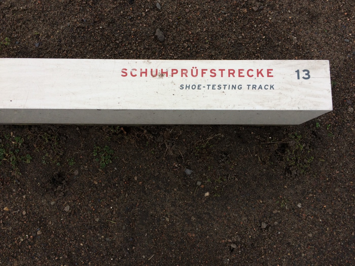 Label for the shoe-testing track, at Sachsenhausen