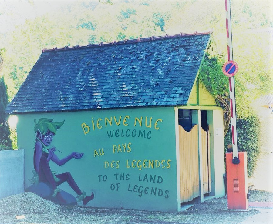 """The entrance to a campsite in Brittany, France, saying """"Welcome to the land of legends."""""""