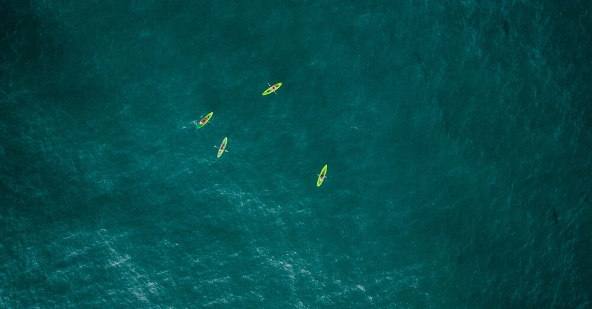 4 kayaks in open water