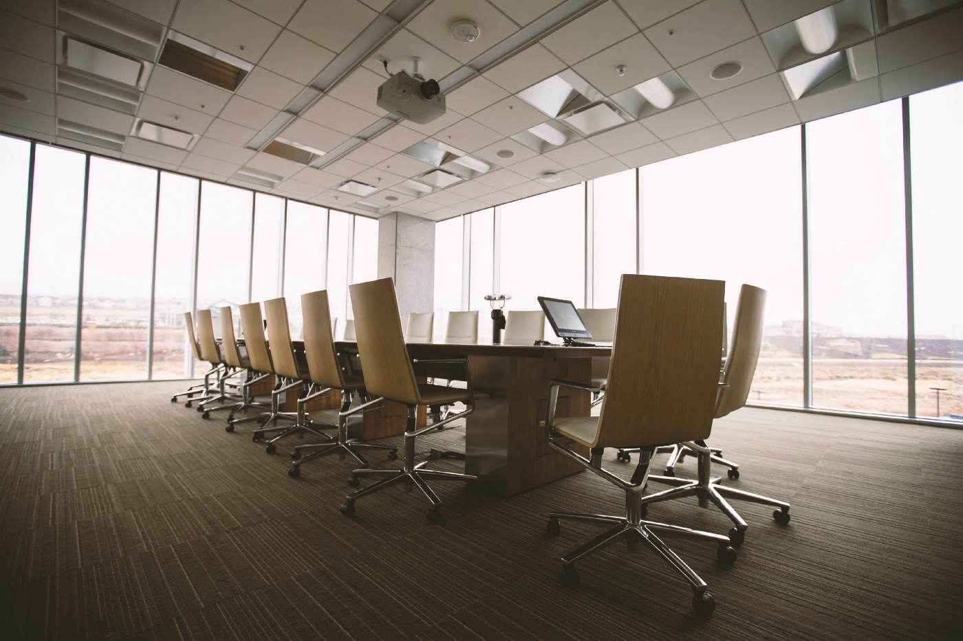 Conference room with floor to ceiling windows, table, and chairs