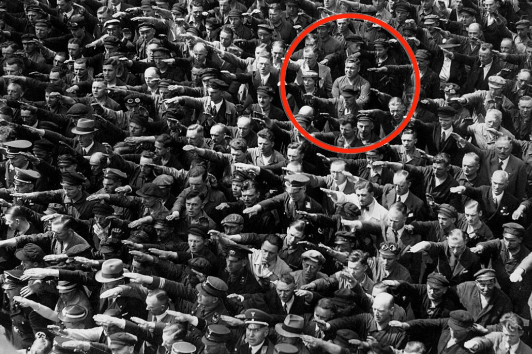 The picture of people giving a Nazi salute, with August Landmesser refusing to do so