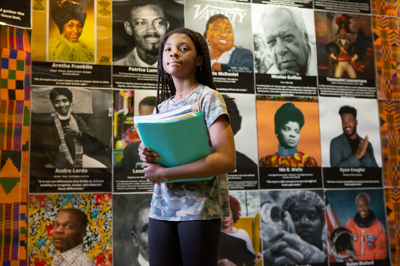 A seventh grader walks by a Black History Month display at Sutton Middle School on her way to class.