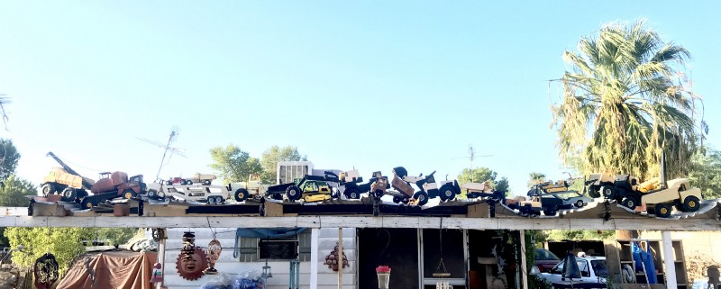 Spike's old Tonka truck collection adorns his carport in Tucson, AZ.