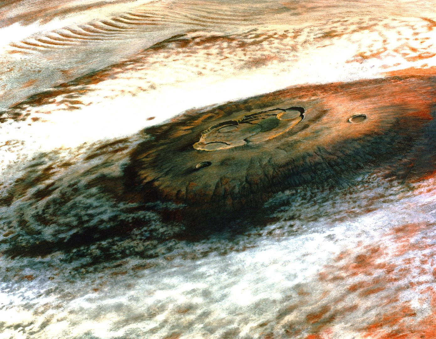Olympus Mons, a Martian volcano, photographed by the Viking 1 spacecraft from 5000 miles away.