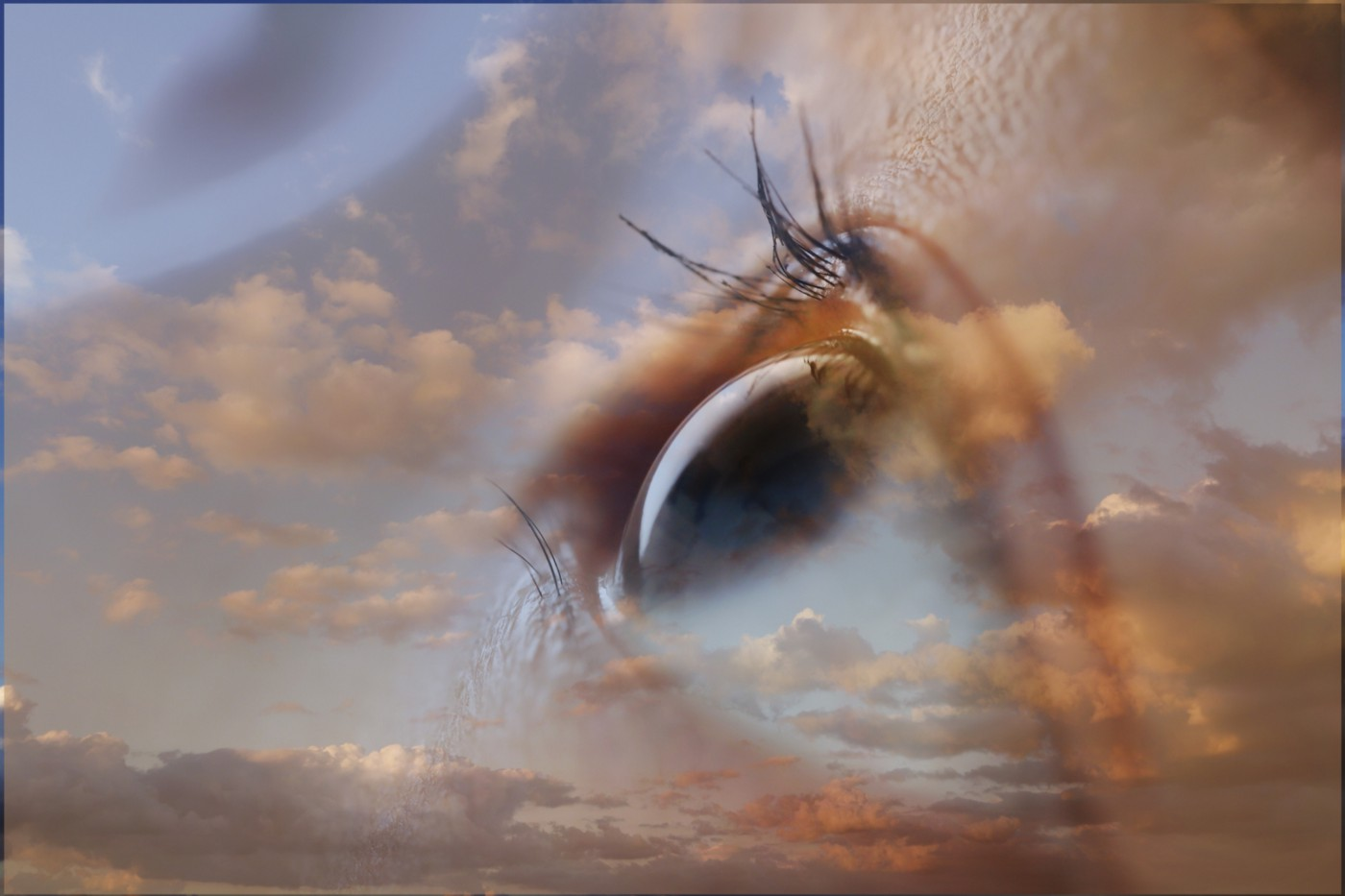 Double exposure image of a person's eye against a cloudy sunset sky.