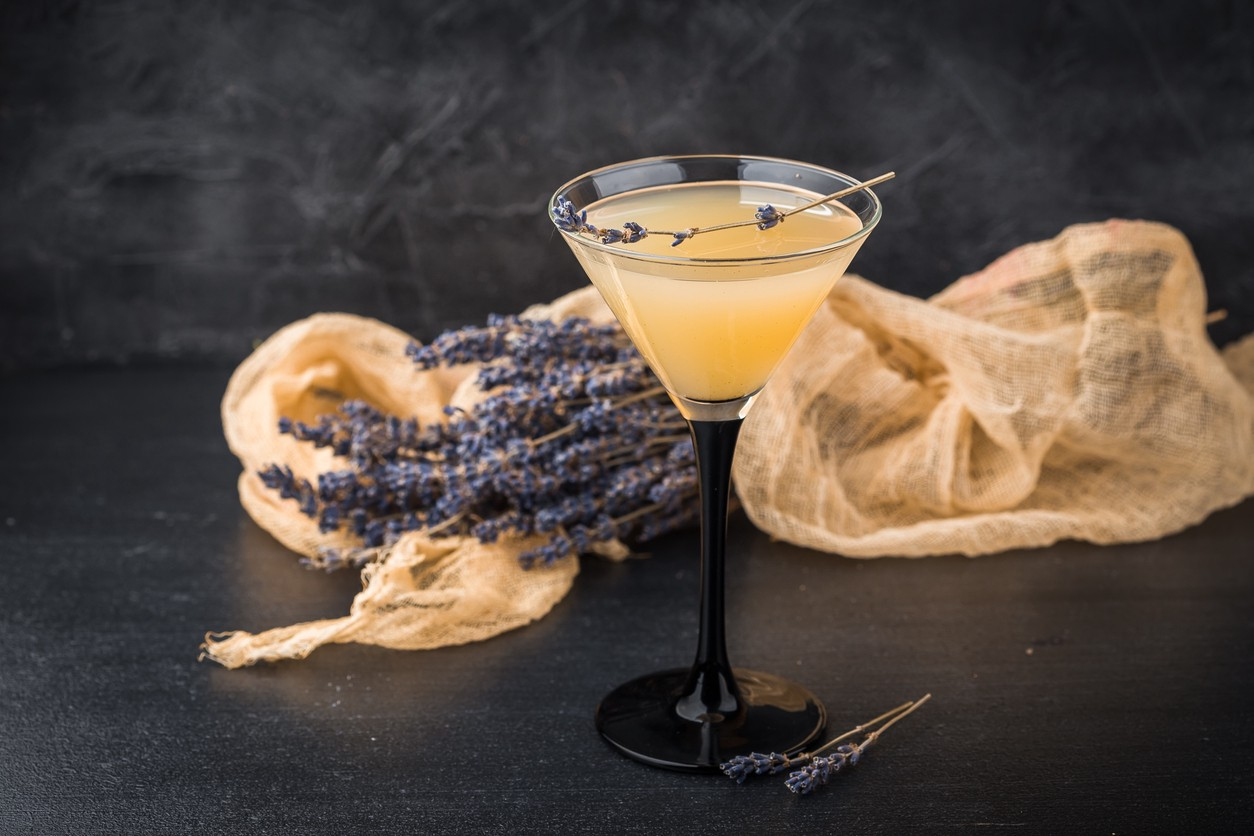 Lemonade martini with lavender on dark background