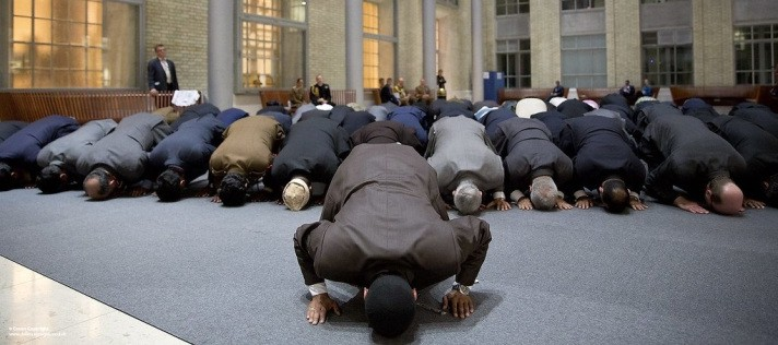Muslim men on the floor praying