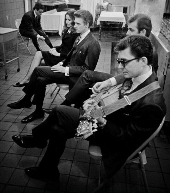 The Statler Brothers and June Carter Cash wait to go onstage as part of the Johnny Cash show at Folsom Prison in 1968.