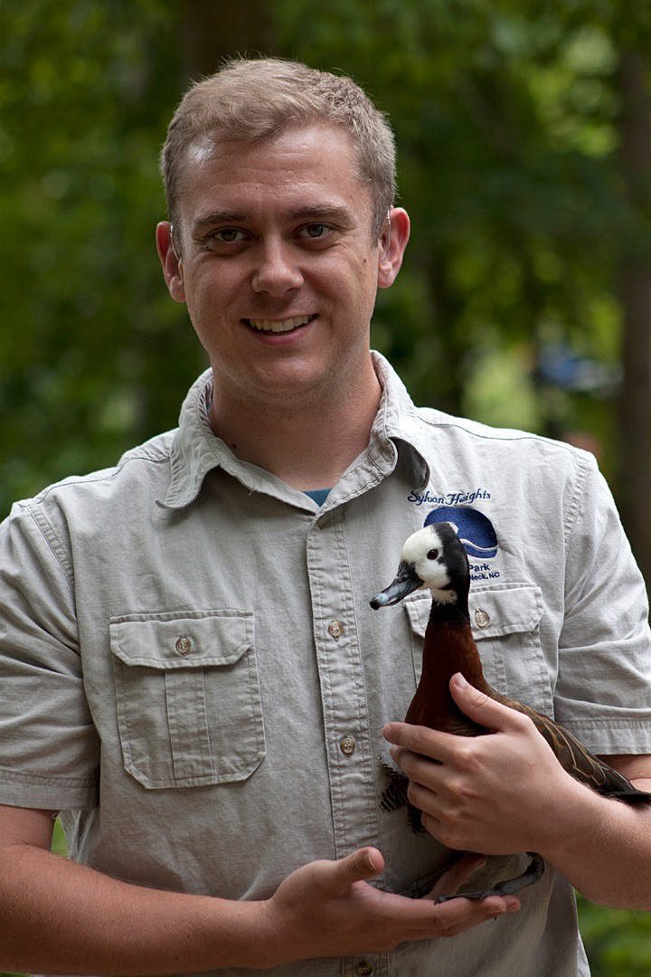 James holding a White-faced Whistling Duck at Sylvan Heights, North Carolina, USA in 2013.