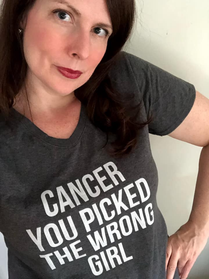 "Woman striking sassy pose and wearing a ""Cancer You Picked the Wrong Girl"" gray and white t-shirt"