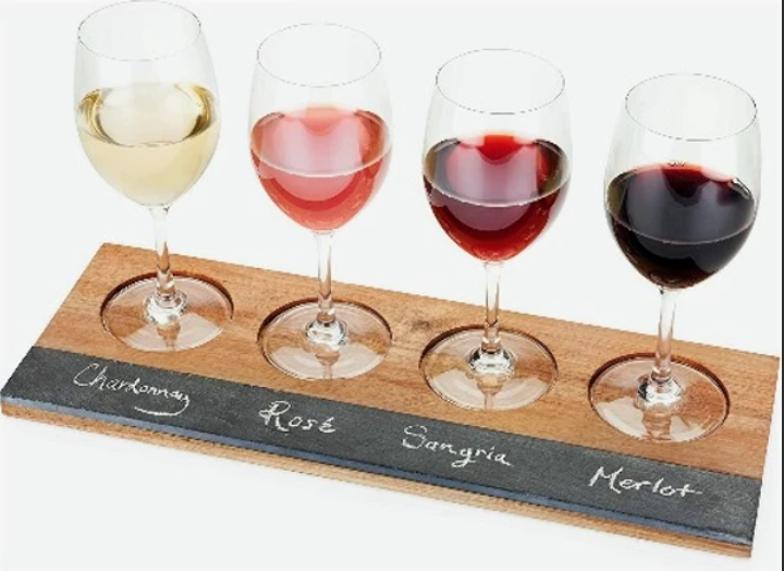 A flight of different wines.