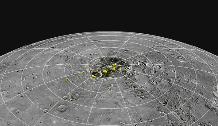 A polar region of Mercury with yellow dots highlighting regions of suspected ice deposits.