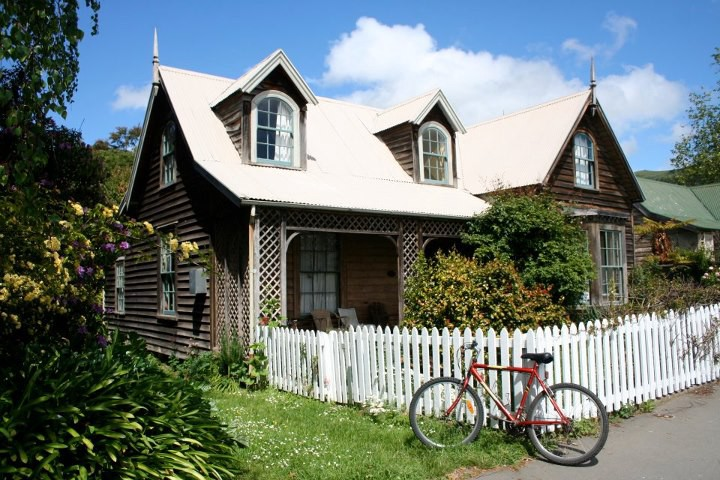 cottage with bike against fence