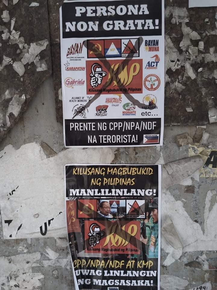 Posters in Manila accusing KMP of being a terrorist front and deceiving peasants.
