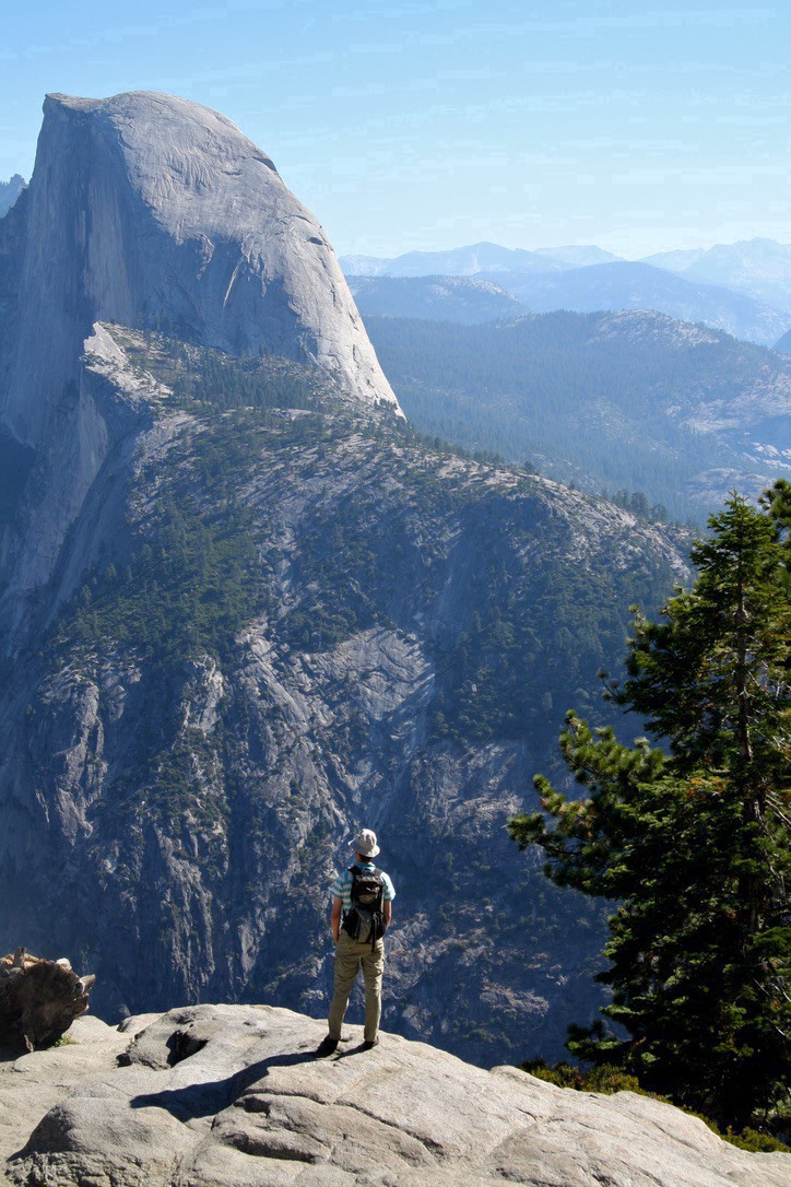 A picture of me looking out over Half Dome in Yosemite National Park.