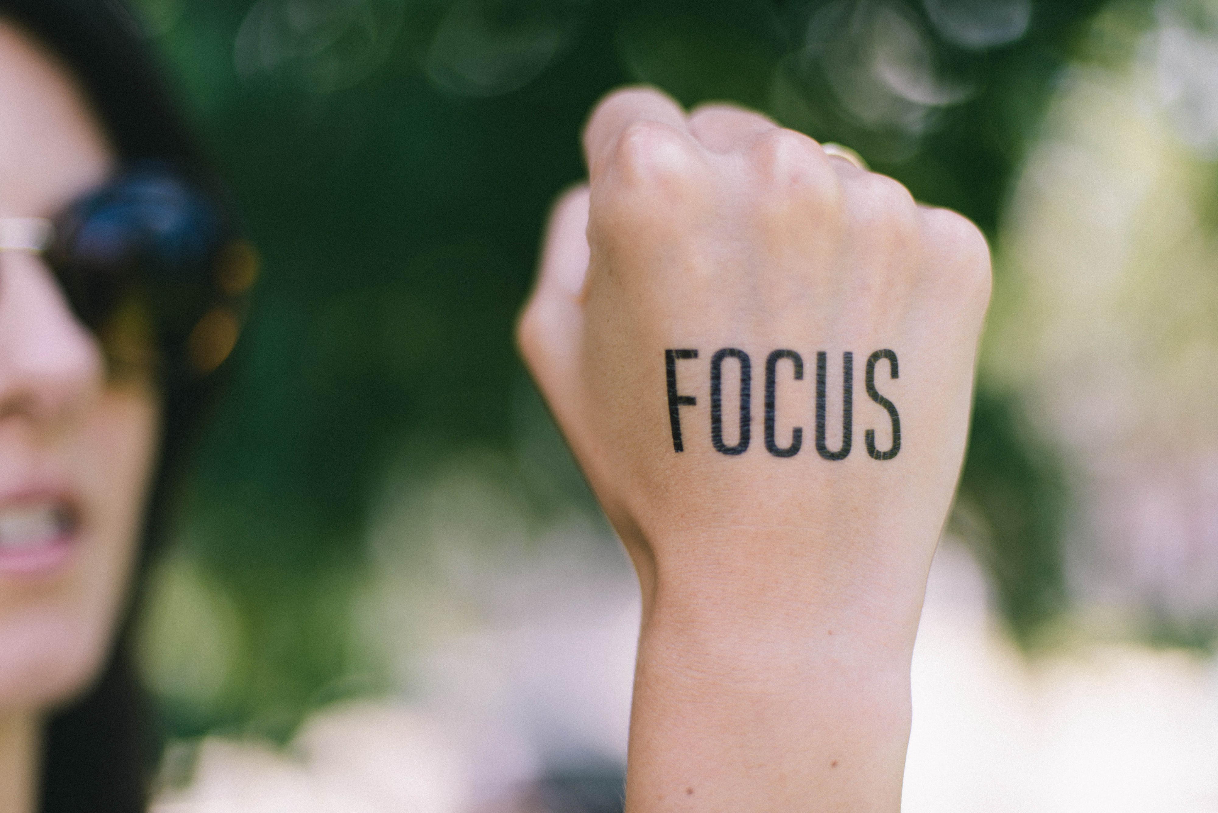 woman with focus written on her hand