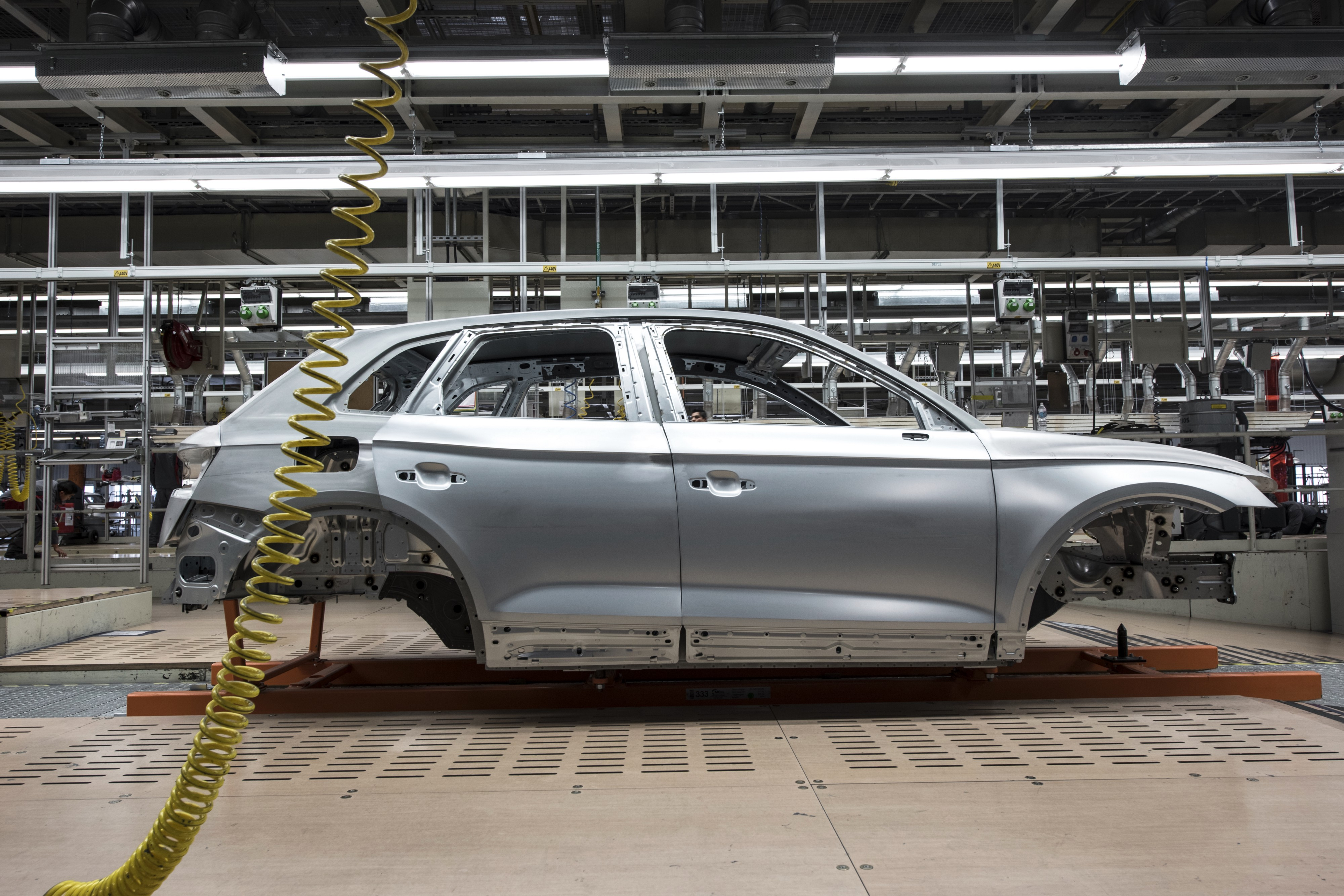 An incomplete car on a production line in a car factory.