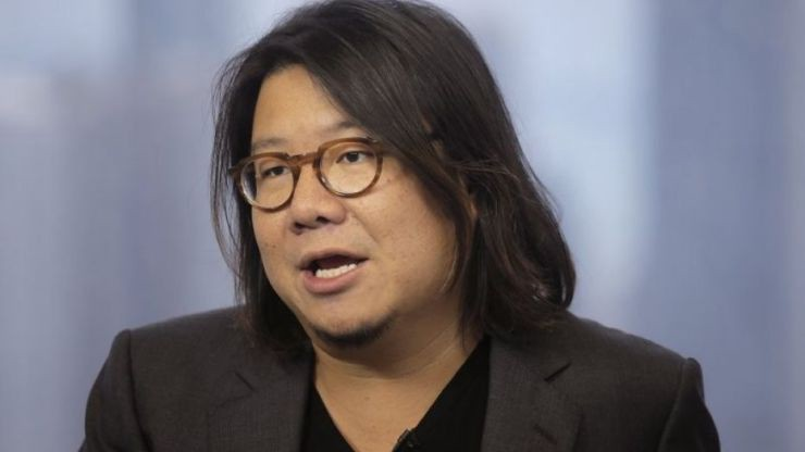 """Crazy Rich Asians"" author Kevin Kwan talks during an interview in Hong Kong. The Singaporean government says Kwan failed to register for national service as required. Kwan left Singapore at age 11 and has lived in the U.S. since then."