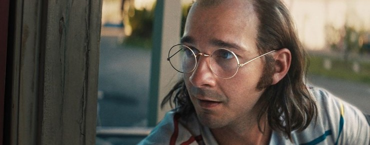 Shia Labeouf playing his father, wearing glasses and balding on top