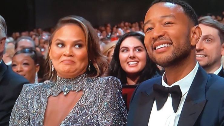 Chrissy Teigan addresses her Emmy Awards facial expression after awkward Colin Jost and Michael opening monologue joke.