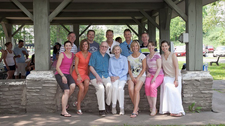 Photo of a large family in a park setting.