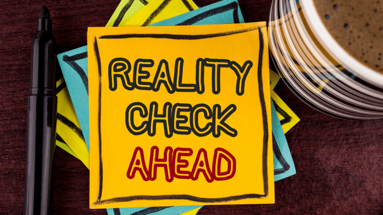 """note card that says, """"reality check ahead"""""""