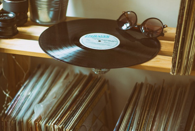 Vinyl disc on top shelf with record collection