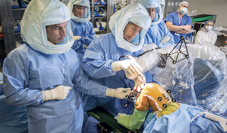 Surgeons in an operating room performing surgery