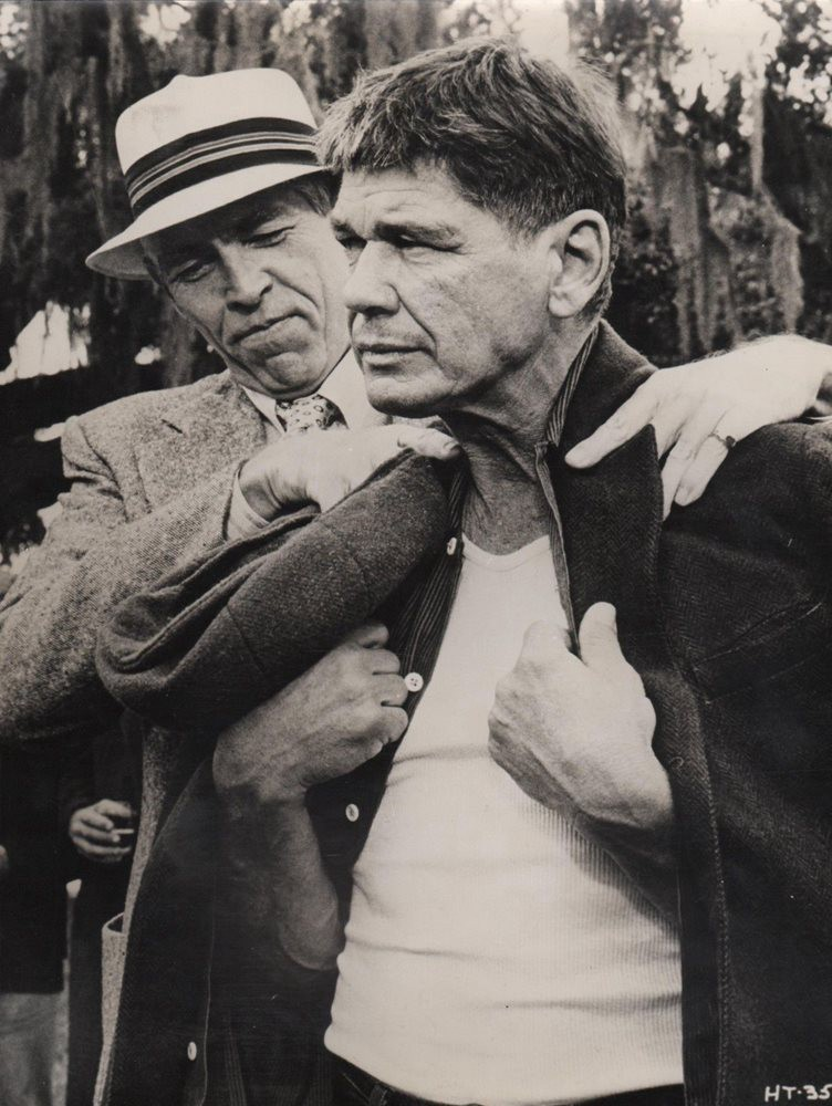 "Promoter James Coburn drapes a coat over reluctant prize fighter Charles Bronson in director Walter Hill's gritty ""Hard Times,"" shot in New Orleans and distributed to glowing reviews on October 8, 1975"