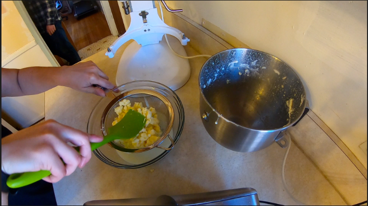Draining the buttermilk from the butter solids