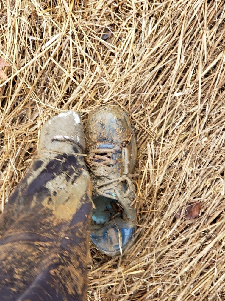 Two muddies shoes, one dug up from two feet of mud.
