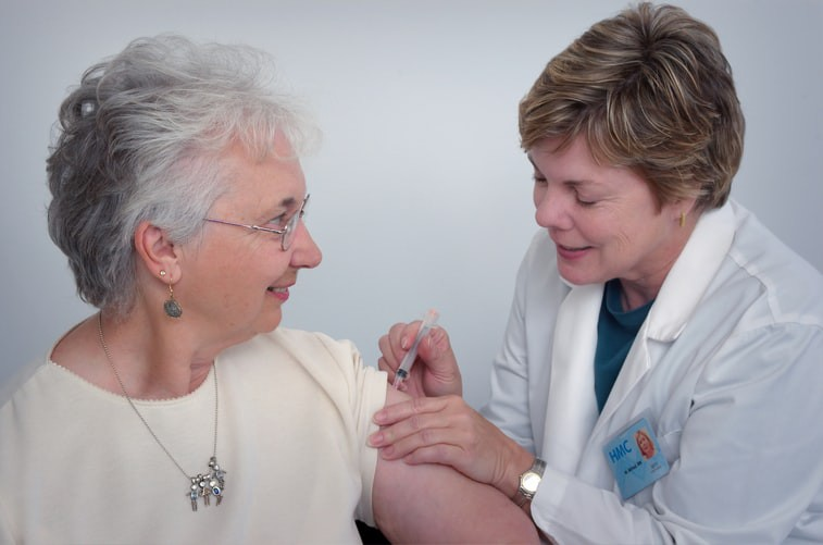 A woman receiving a Covid19 vaccination.
