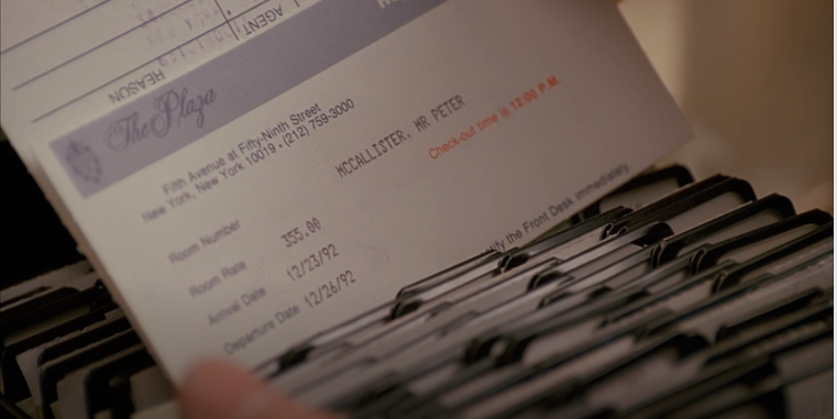 Screenshot from Home Alone 2, closeup of Plaza Hotel reservation card for Peter McAllister with a room rate of $355 per night