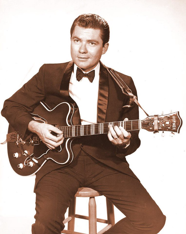A Hofner electric guitar-wielding Lew DeWitt is a classy tuxedo-clad singer-songwriter in this mid-1960s promotional still.