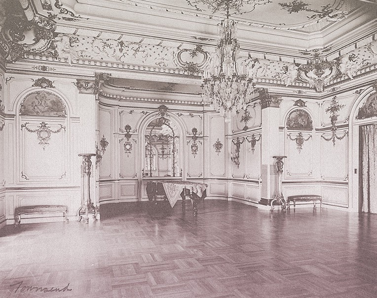 The ornate Townsend ballroom, with plaster molding, gilding, a crystal chandelier, and parquet floor.