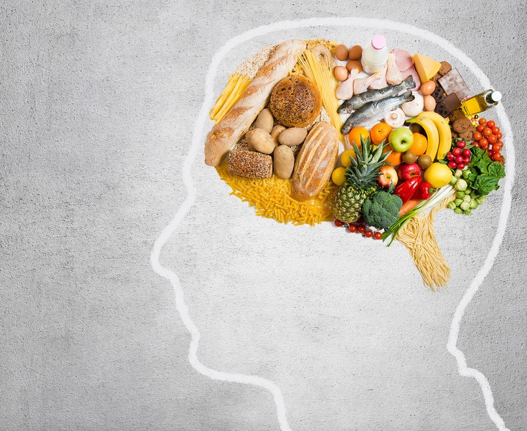 A profile outline of a human head with various foods in place of a brain.