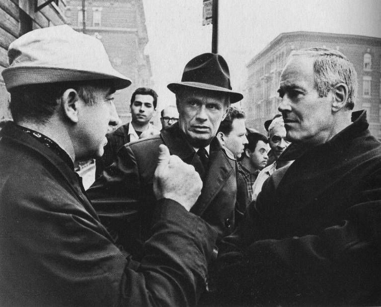 """Director Don Siegel gives scene feedback to Richard Widmark and Henry Fonda on location in New York City for 1968's """"Madigan"""""""